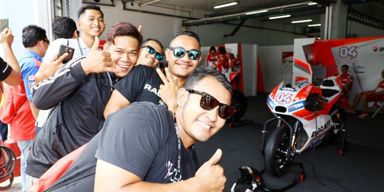 Lucky mechanics invited by Shell Advance pose at the Ducati garage
