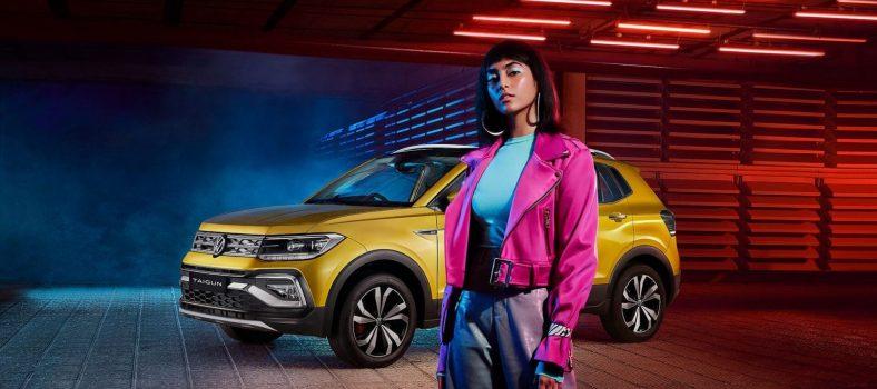 Volkswagen Taigun Crossover with model in studio 1.0